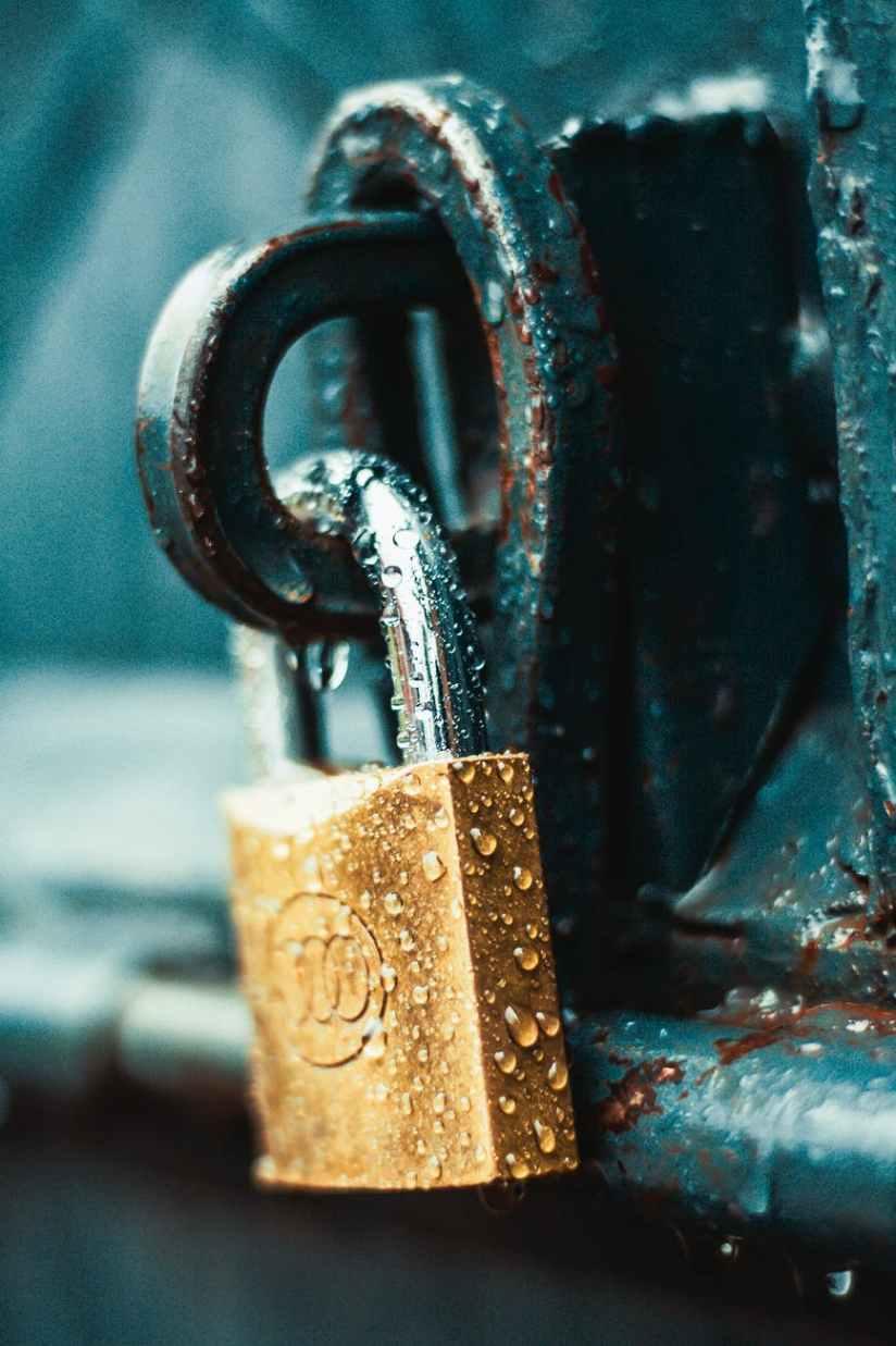 close up photography of wet padlock