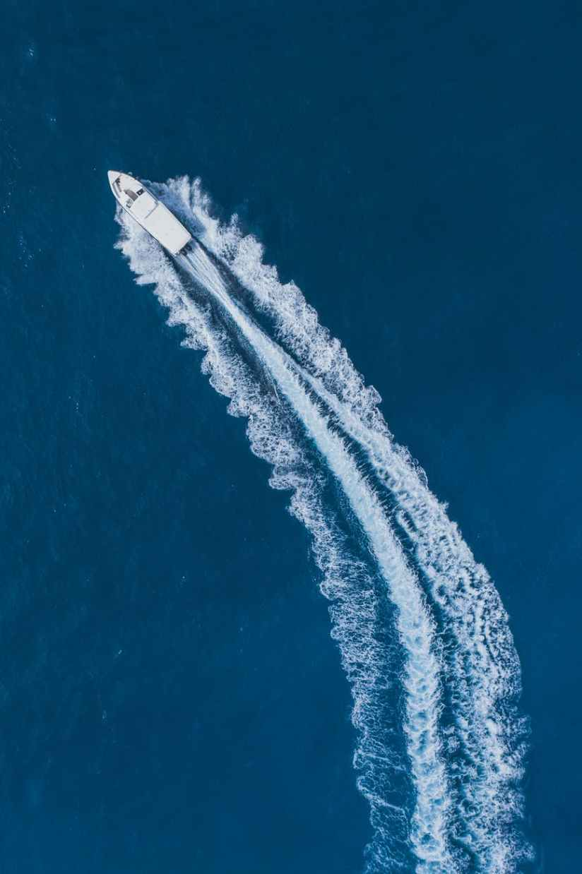 top view photo of speedboat on sea